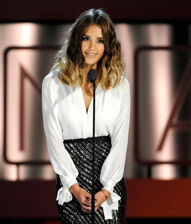 . Jessica Alba presents an award on stage at the NCLR ALMA Awards at the Pasadena Civic Auditorium on Friday, Sept. 27, 2013, in Pasadena, Calif. (Photo by Chris Pizzello/Invision/AP)