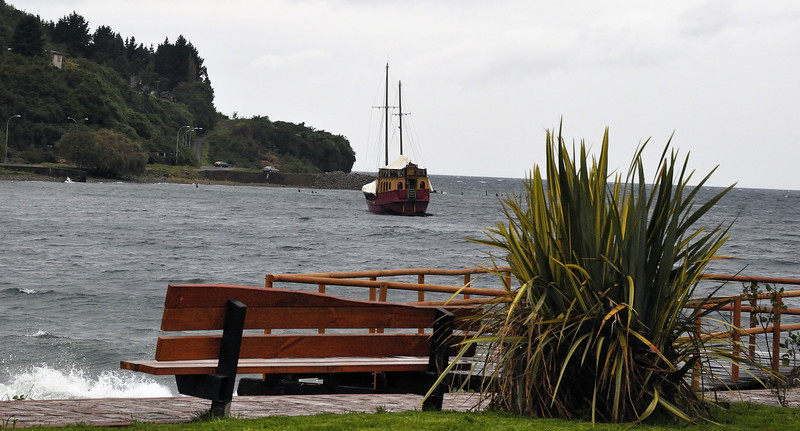08  april puerto varras boat in bay bench.jpg