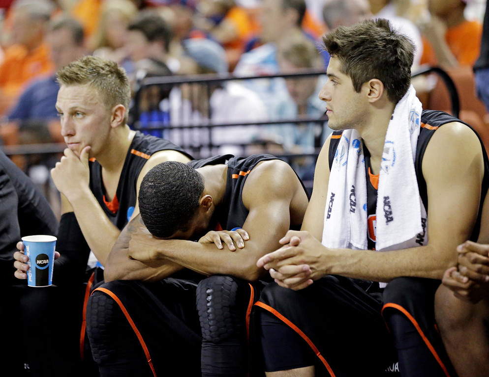 . Pacific players react on the bench during the second half of a second-round game of the NCAA college basketball tournament against the Miami Friday, March 22, 2013, in Austin, Texas. Miami beat Pacific 78-49. (AP Photo/David J. Phillip)