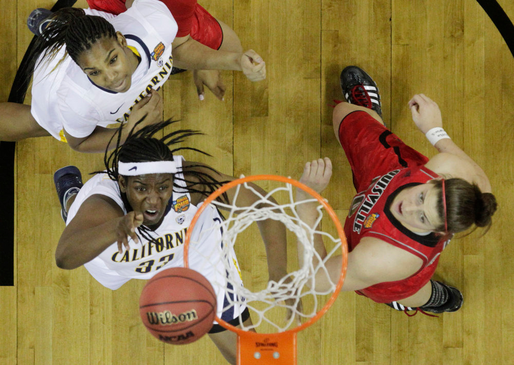 Description of . California center Talia Caldwell (33) goes up for a shot against Louisville forward Sara Hammond (00) in the first half of a national semifinal at the Women's Final Four of the NCAA college basketball tournament, Sunday, April 7, 2013, in New Orleans. At left is California forward Reshanda Gray (21). (AP Photo/Dave Martin)