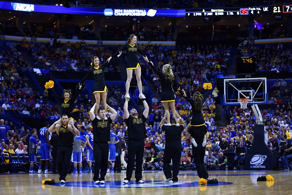 . Wichita State Shockers cheerleaders perform against the Kentucky Wildcats during the third round of the 2014 NCAA Men\'s Basketball Tournament at Scottrade Center on March 23, 2014 in St Louis, Missouri.  (Photo by Dilip Vishwanat/Getty Images)