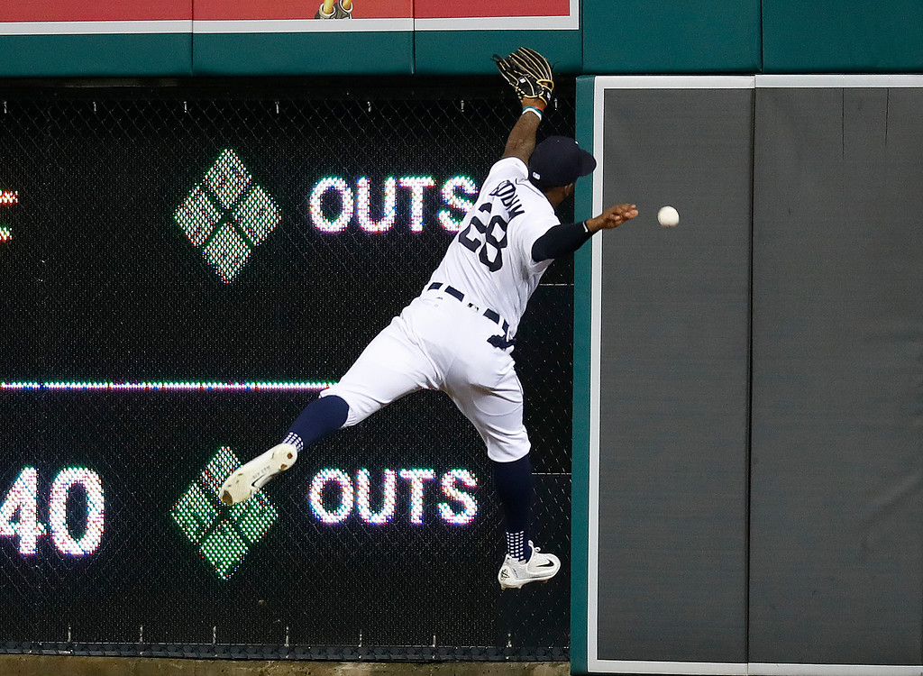 . Detroit Tigers right fielder Niko Goodrum reaches but cannot catch a Cleveland Indians\' Edwin Encarnacion one-run double in the eighth inning of a baseball game in Detroit, Monday, May 14, 2018. (AP Photo/Paul Sancya)