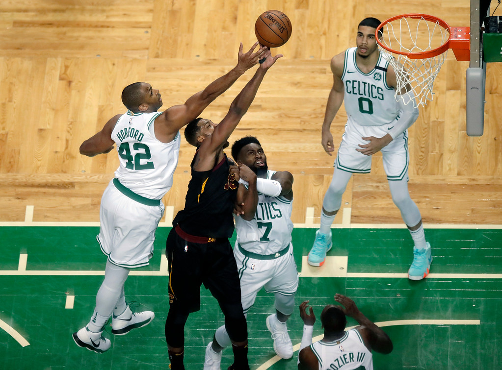 . Boston Celtics forward Al Horford (42) battles Cleveland Cavaliers center Tristan Thompson (13) for the ball during the first half in Game 7 of the NBA basketball Eastern Conference finals, Sunday, May 27, 2018, in Boston. (AP Photo/Charles Krupa)