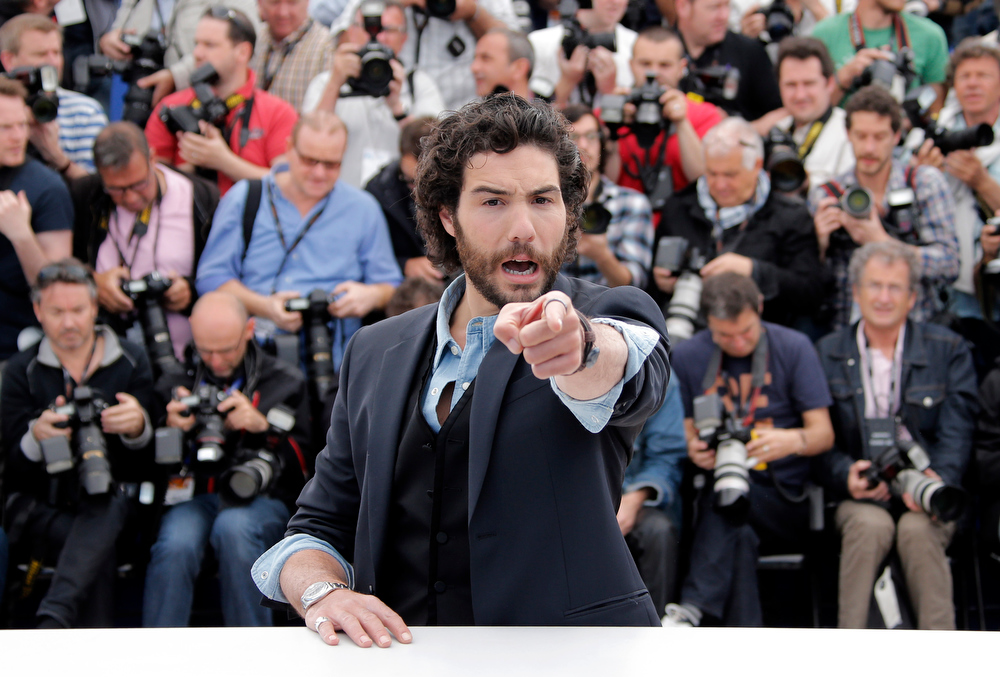 . Actor Tahar Rahim poses for photographers during a photo call for the film The Past at the 66th international film festival, in Cannes, southern France, Friday, May 17, 2013. (AP Photo/Francois Mori)