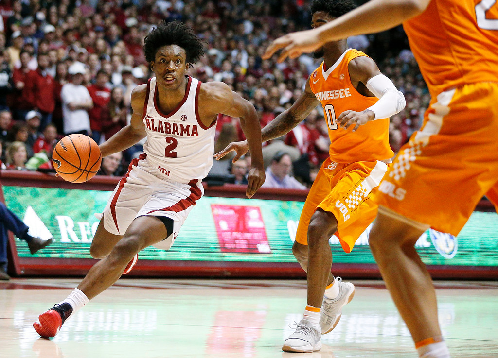 . Alabama guard Collin Sexton drives the ball to the basket against Tennessee guard Jordan Bone during the second half of an NCAA college basketball game Saturday, Feb. 10, 2018, in Tuscaloosa, Ala. Alabama won 78-50. (AP Photo/Brynn Anderson)