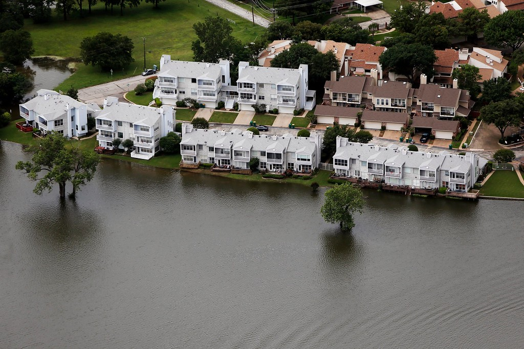 . Lake Lewisville encroaches upon multi-family dwellings, Friday, May 29, 2015 in Lewisville, Texas. Floodwaters submerged Texas highways and threatened more homes Friday after another round of heavy rain added to the damage inflicted by storms. (AP Photo/Brandon Wade)