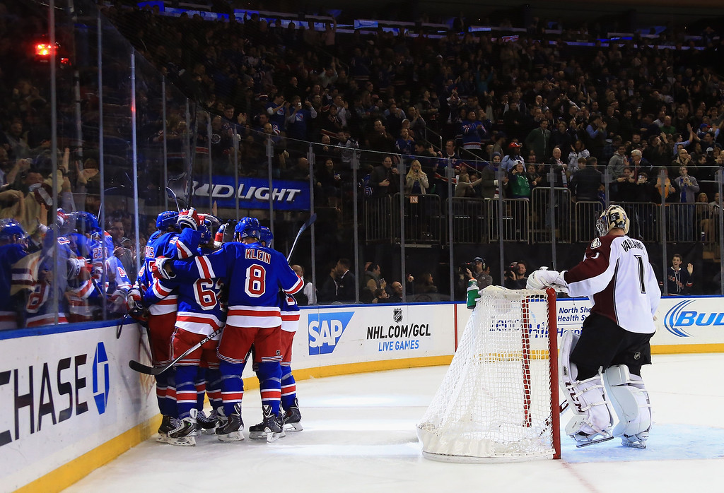 . NEW YORK, NY - NOVEMBER 13: The New York Rangers celebrate a goal by Kevin Hayes #13 at 6:42 of the second period against Semyon Varlamov #1 of the Colorado Avalanche at Madison Square Garden on November 13, 2014 in New York City.  (Photo by Bruce Bennett/Getty Images)