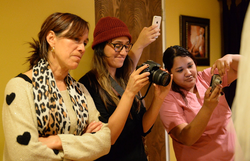 . Midwife Simona Istrate guides Lilibeth and Luis Salas, of El Monte, through the birth of their son, Nicholas, by water birth at the Natural Birth Center and Women\'s Wellness in Whittier on December 29, 2013. Birthing centers and home births are becoming more popular and the Birth Center in Whittier is doing so well it opened a second office in Beverly Hills. (Staff Photo by Keith Durflinger/Whittier Daily News)