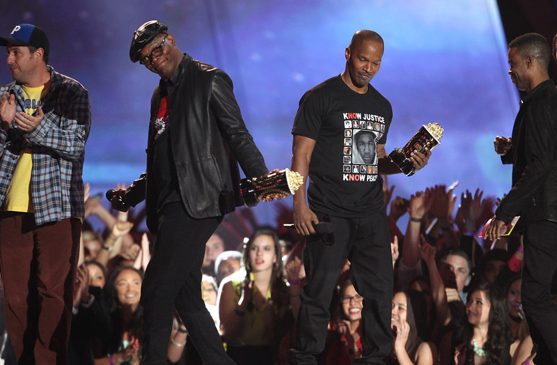 """. Jamie Foxx, right, and Samuel L. Jackson accept the award for best WTF moment for \""""Django Unchained\"""" at the MTV Movie Awards in Sony Pictures Studio Lot in Culver City, Calif., on Sunday April 14, 2013. (Photo by Matt Sayles/Invision /AP)"""