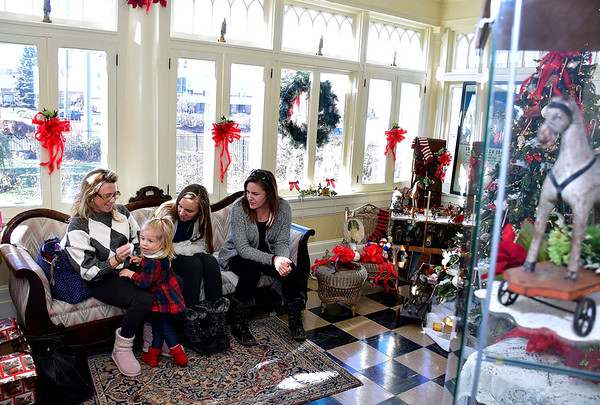 11/30/2019 Mike Orazzi | Staff Amy Rae and her daughter Gigi,2, wait to see Santa at The Barnes Museum in Southington on Saturday morning with long time friend Christina Wessels and her daughter Cami.