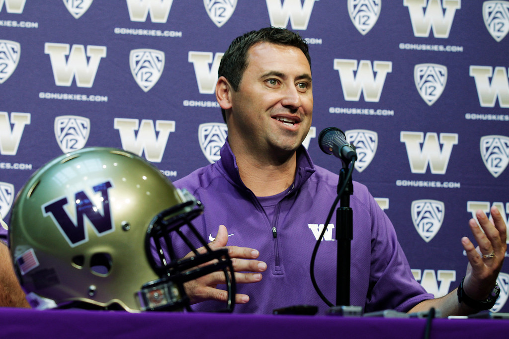 . Washington NCAA college football coach Steve Sarkisian talks to reporters, Monday, Aug. 6, 2012, in Seattle, on the opening day of Washington football practice. (AP Photo/Ted S. Warren)