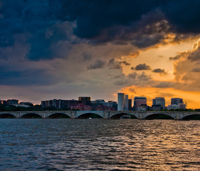 Sunset on the Potomac River, over the Arlington Memorial Bridge and the Rosslyn Skyline, seen from Washington, DC.