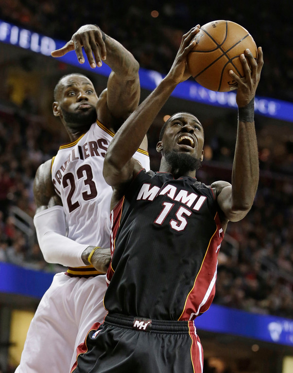 . Miami Heat\'s Okaro White (15) drives to the basket against Cleveland Cavaliers\' LeBron James (23) in the second half of an NBA basketball game, Monday, March 6, 2017, in Cleveland. The Heat won 106-98. (AP Photo/Tony Dejak)