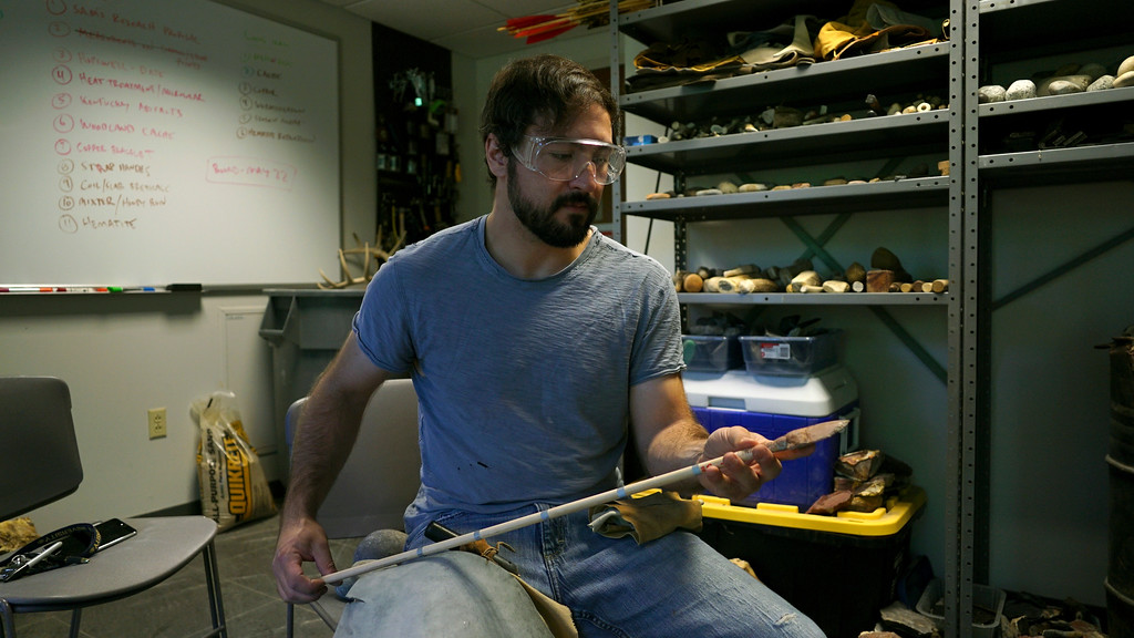 . In this June 1, 2017, photo, Metin Eren, an archaeologist at Kent State University, examines an imitation of an ancient arrow in Kent, Ohio. Eren runs a newly-opened laboratory which makes replicas of ancient arrows, knives, and pottery to be shot, crushed, and smashed. It\'s allowing researchers to learn about engineering techniques of the first native Americans without destroying priceless genuine relics in the process. (AP Photo/Dake Kang)