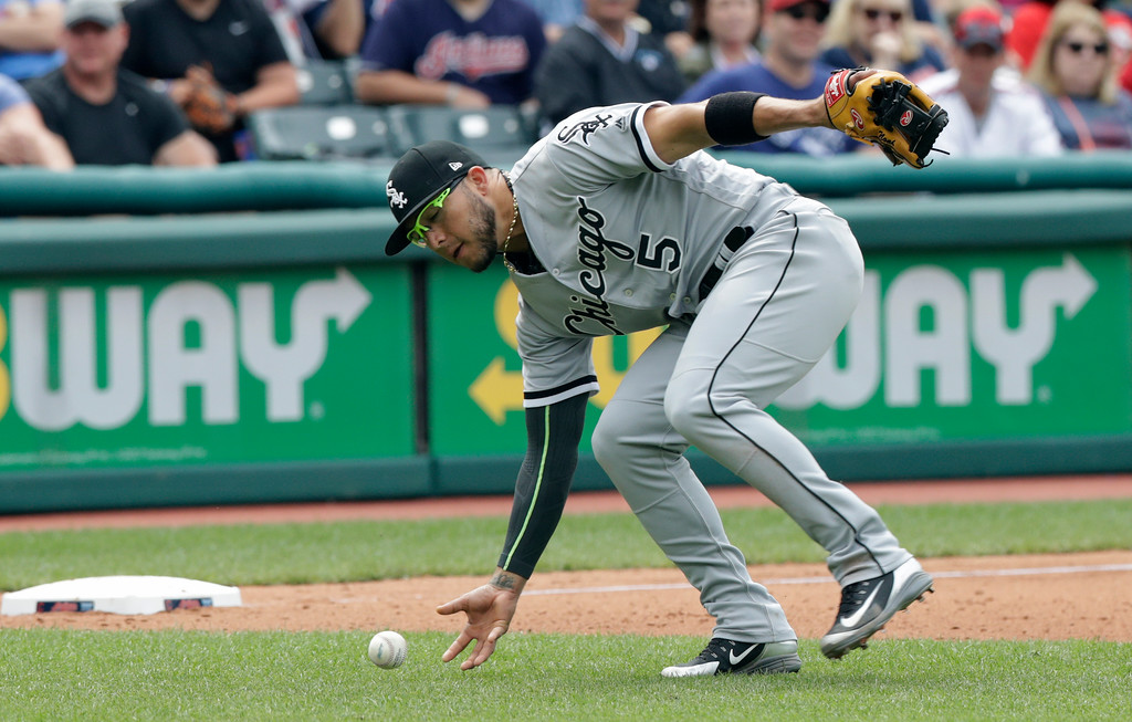 . Chicago White Sox\'s Yolmer Sanchez fields a ball hit by Cleveland Indians\' Erik Gonzalez in the seventh inning of a baseball game, Wednesday, June 20, 2018, in Cleveland. Gonzalez was safe at first base. (AP Photo/Tony Dejak)