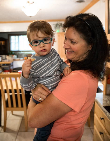 Mom Holding Caleb in the kitchen.jpg