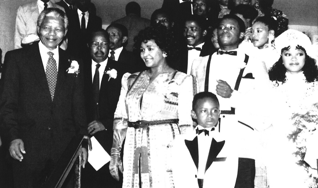 . The Mandela family leaves the church after the marriage of their youngest daughter Zindzi, right, in Johannesburg on Saturday, Oct. 24, 1992. Front, from left, African National congress leader Nelson Mandela, his estranged wife Winnie Mandela, and the groom Zweli Hlongwane. The wedding was the first of any of Nelson Mandela?s children that he has attended. (AP Photo/Greg Marinovich)