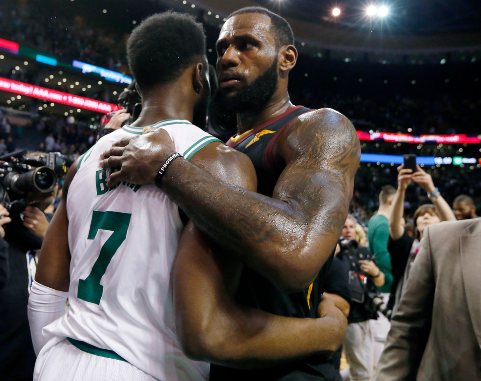 . Cleveland Cavaliers forward LeBron James, right, embraces Boston Celtics guard Jaylen Brown after the Cavaliers beat the Celtics 87-79 in Game 7 of the NBA basketball Eastern Conference finals, Sunday, May 27, 2018, in Boston. (AP Photo/Elise Amendola)