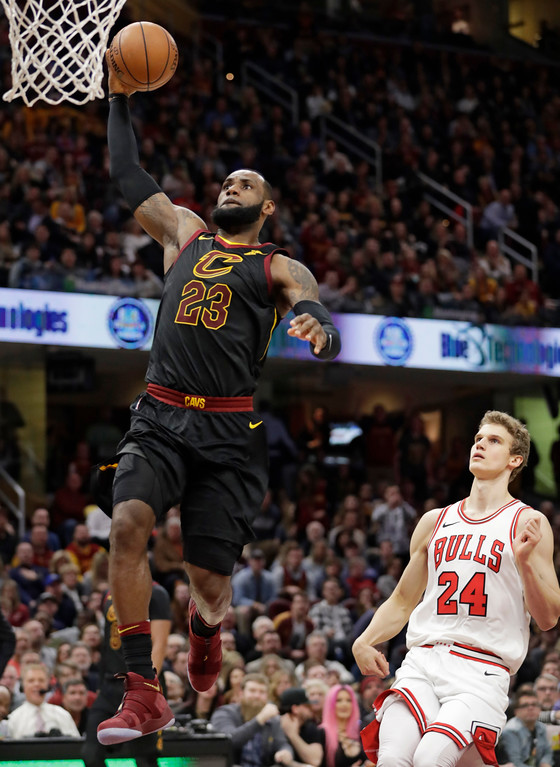 . Cleveland Cavaliers\' LeBron James (23) drives to the basket past Chicago Bulls\' Lauri Markkanen (24), from Finland, durign the first half of an NBA basketball game Thursday, Dec. 21, 2017, in Cleveland. (AP Photo/Tony Dejak)