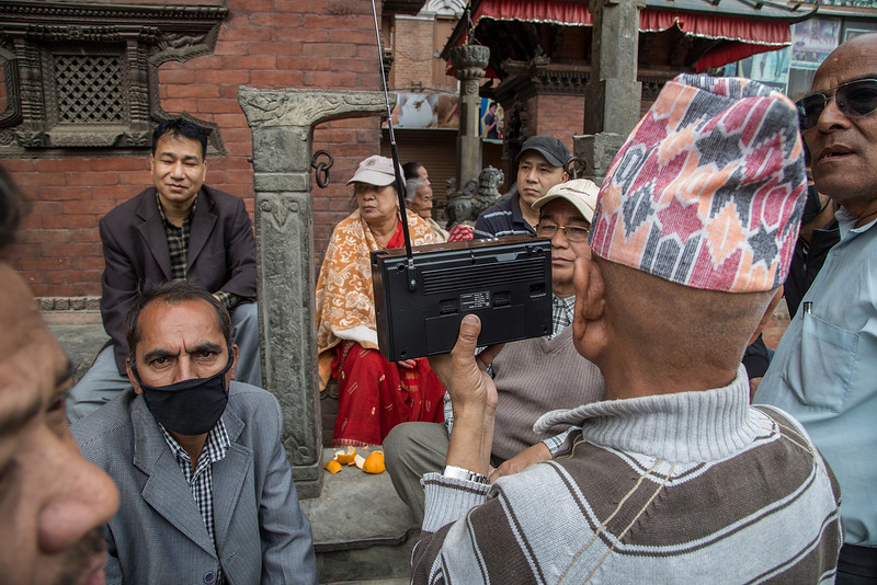 . A group of people listen to news updates on a radio near Basantapur Durbar Square following an earthquake on April 25, 2015 in Kathmandu, Nepal. A major 7.8 earthquake hit Kathmandu mid-day on Saturday, and was followed by multiple aftershocks that triggered avalanches on Mt. Everest that buried mountain climbers in their base camps. Many houses, buildings and temples in the capital were destroyed during the earthquake, leaving hundreds dead or trapped under the debris as emergency rescue workers attempt to clear debris and find survivors.  (Photo by Omar Havana/Getty Images)