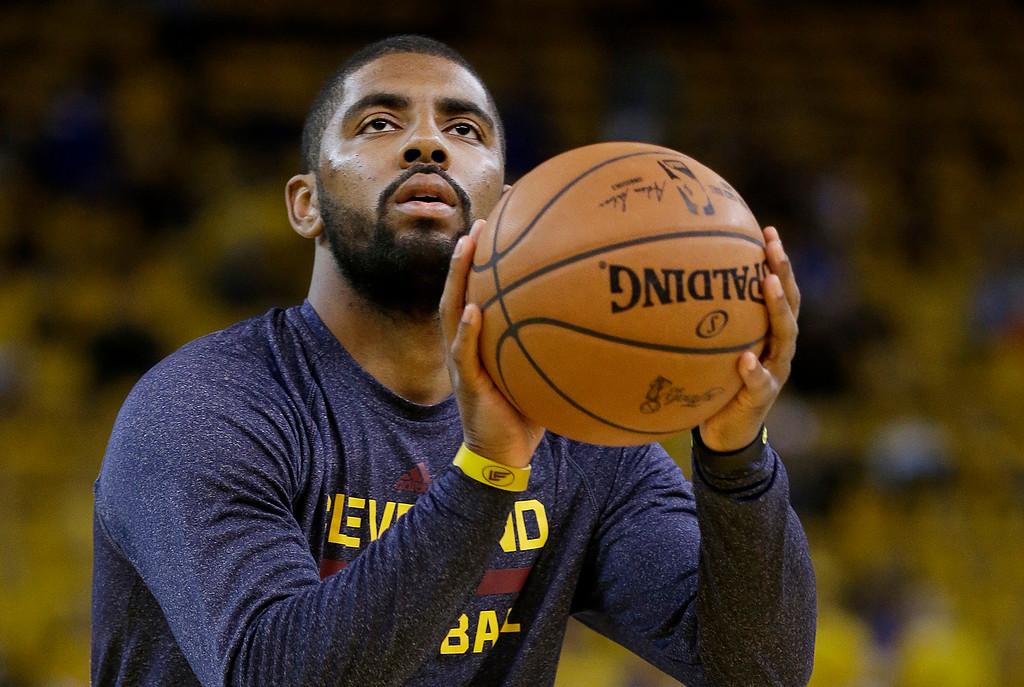 . Cleveland Cavaliers guard Kyrie Irving warms up before Game 1 of basketball\'s NBA Finals against the Golden State Warriors in Oakland, Calif., Thursday, June 4, 2015. (AP Photo/Ben Margot)