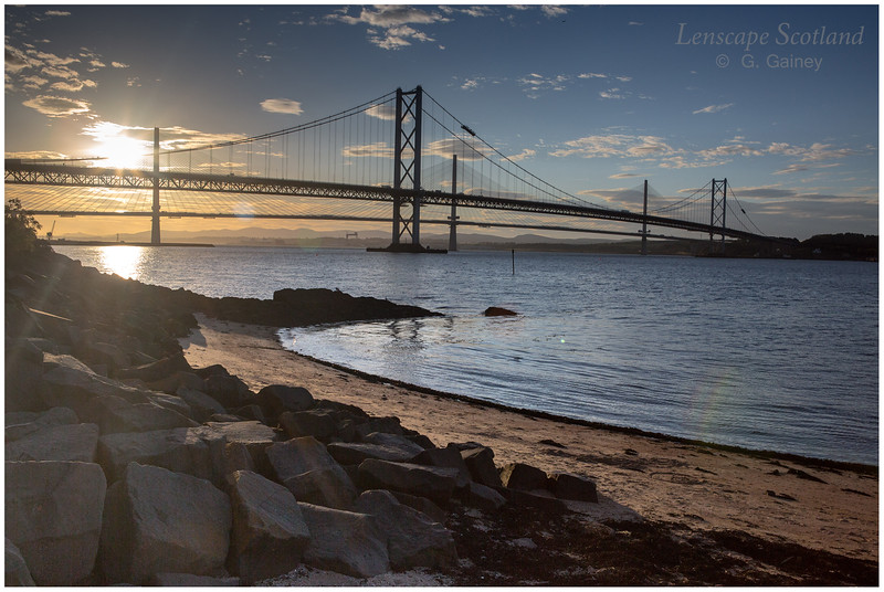 Forth Road Bridge and Queensferry Crossing from Queensferry harbour