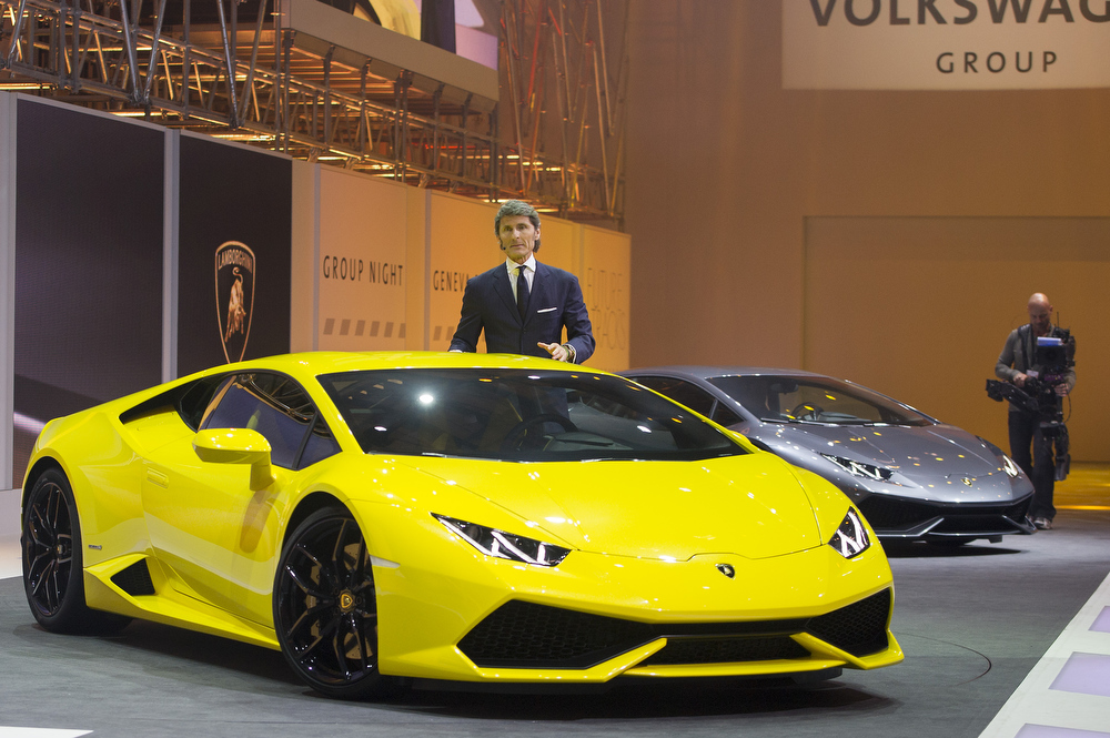 Description of . Lamborghini President and CEO Stephan Winkelmann presents the new Lamborghini Huracan as a world premiere during the Volkswagen Group preview ahead of the opening day of the 84th International Motor Show which will showcase novelties of the car industry on March 3, 2014 in Geneva, Switzerland.  (Photo by Harold Cunningham/Getty Images)
