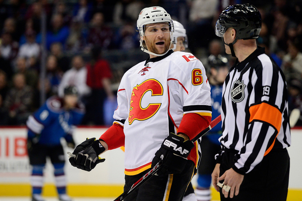 . Dennis Wideman (6) of the Calgary Flames jaws with a referee while playing the Colorado Avalanche during the third period of the Flames\' 4-3 win. (Photo by AAron Ontiveroz/The Denver Post)