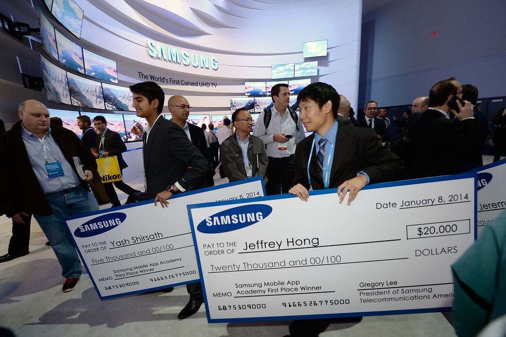 . Samsung Mobile App Academy Scholarship winners Yash Shirsath, left, and Jeffrey Hong walk through the Samsung booth at International CES 2014 on Wednesday, Jan. 8, 2014 in Las Vegas. (Jeff Bottari/AP Images for Samsung)
