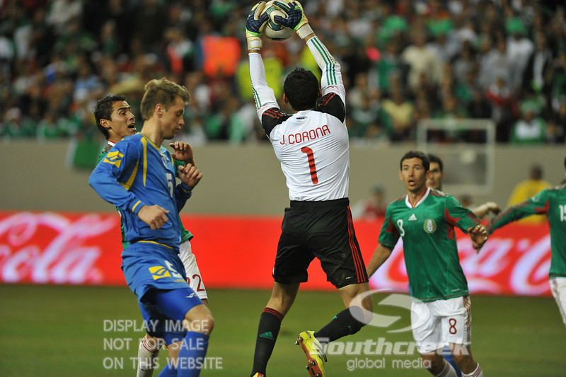 Mexico's Goalkeeper Jesus Corona (#1) catches the ball in front of the goal in Soccer action between Bosnia-Herzegovina and Mexico.  Mexico defeated Bosnia-Herzegovina 2-0 in the game at the Georgia Dome in Atlanta, GA.