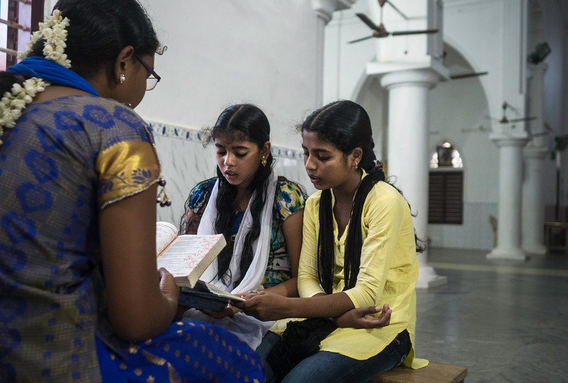Young girls rehearsing the songs and prayers to be performed for the Sunday mass in St. Mathews Church, Pallam. While in cities we see the people are moving away from the religion, here people attend mass at least two times  a day and also whenever they are free they come to pray after a tiring day at work.