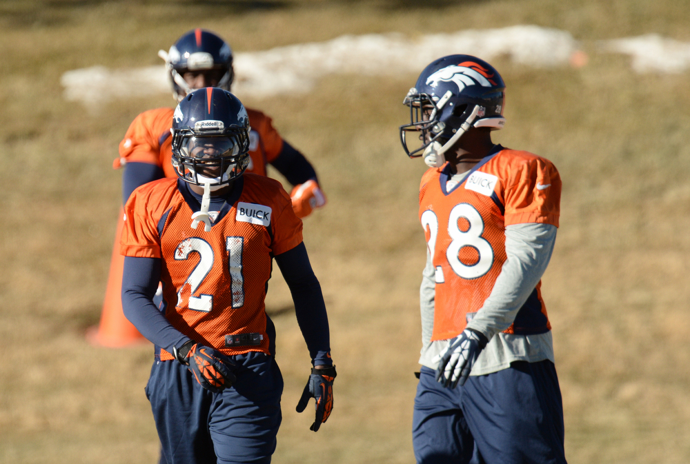 . Denver Broncos Ronnie Hillman (21) and Montee Ball (28) are warming up for the team practice at Dove Valley. Centennial Colorado. January 17. 2014. (Photo by Hyoung Chang/The Denver Post)