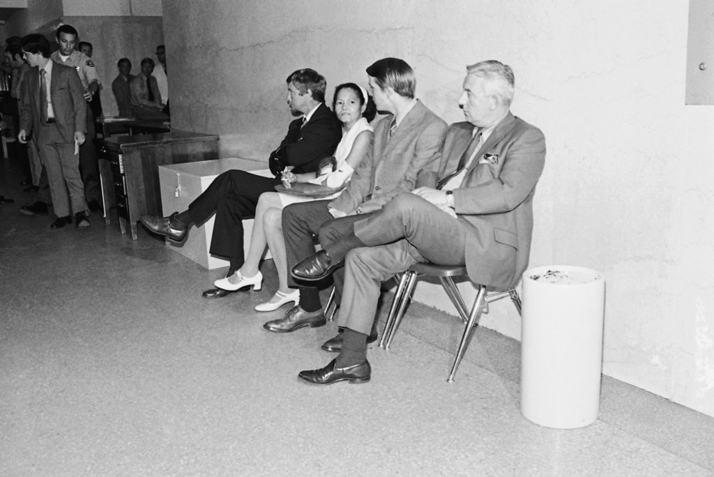 . Four witnesses expected to be among the first called in the Tate-LaBianca murder trial sit in a corridor of the Los Angeles Hall of Justice, July 21, 1970 waiting to be summoned into the courtroom. Left to right: Paul J. Tate, father of actress Sharon Tate; Winifred Chapman, who discovered the five bodies at the Tate Home; Dennis Hearst, whose connection with the case was not immediately revealed; and Wilfred Parent, father of a victim, Steven Parent. At far left is another witness, William E. Garretson, caretaker at the Tate home. (AP Photo/Wally Fong)