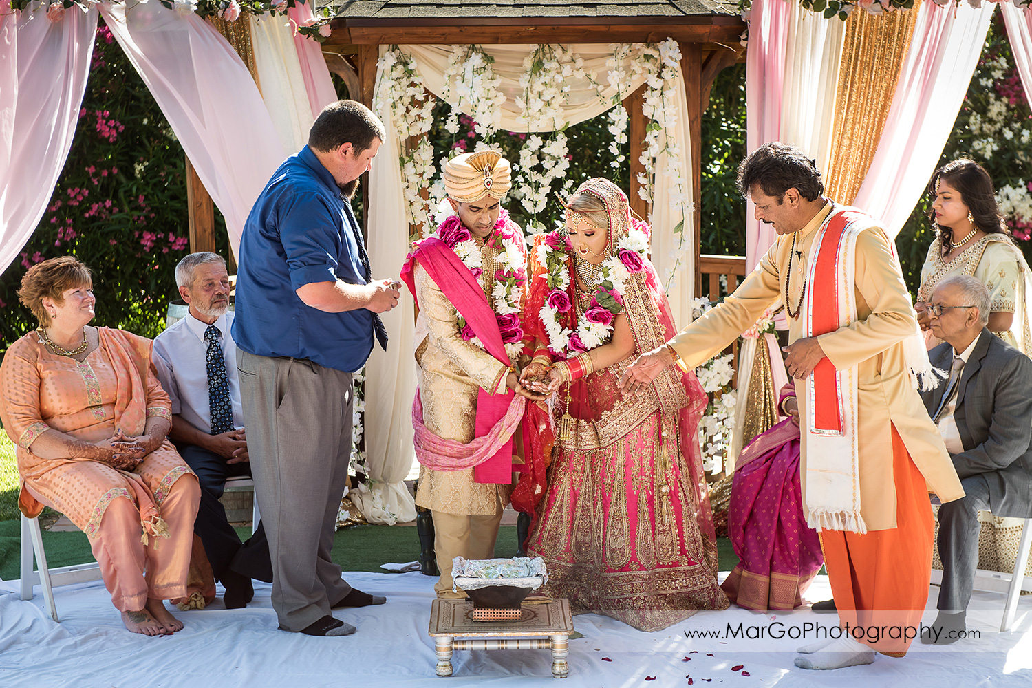 Indian bride and groom in front of fire during Mangalphera - walking around Agni at Elliston Vineyards in Sunol