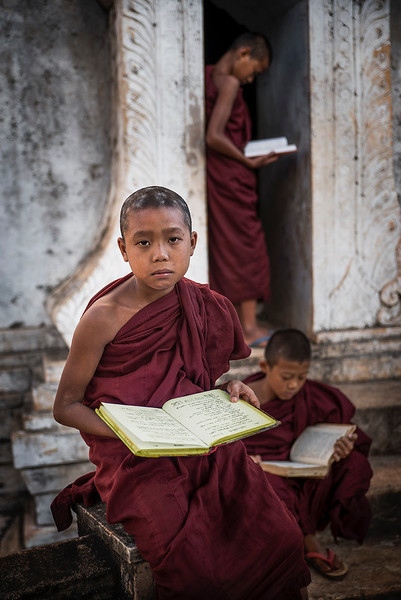 Young monks reading in a temple in the town of Pindaya.  Pindaya, Myanmar, 2017.