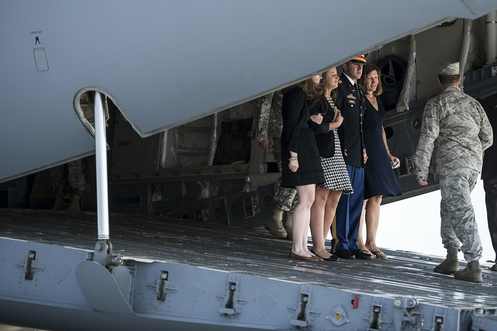 . The wife of US Army Maj. Gen. Harold J. Greene, Susan Myers (2ndR), son US Army First Lieutenant Matthew Greene (C), daughter-in-law Kasandra Greene (2nd L), daughter Amelia Greene (L) walk of a C-17 after speaking with the flight crew after a dignified transfer at Dover Air Force Base on August 7, 2014 in Delaware.   AFP PHOTO/Brendan SMIALOWSKI/AFP/Getty Images