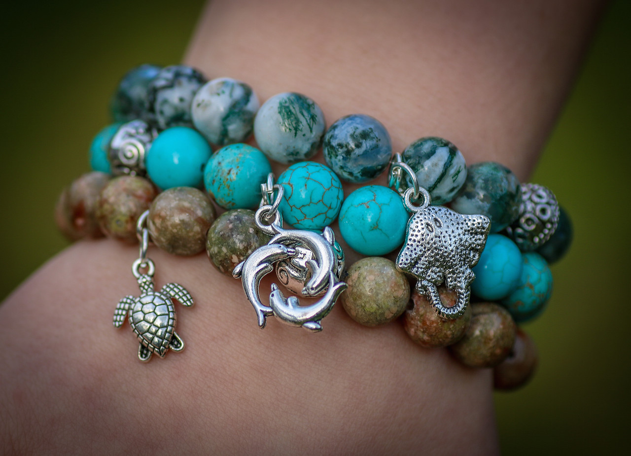 The Marine Life Collection includes a turtle, dolphin family and spotted ray in a set of handcrafted bracelets.