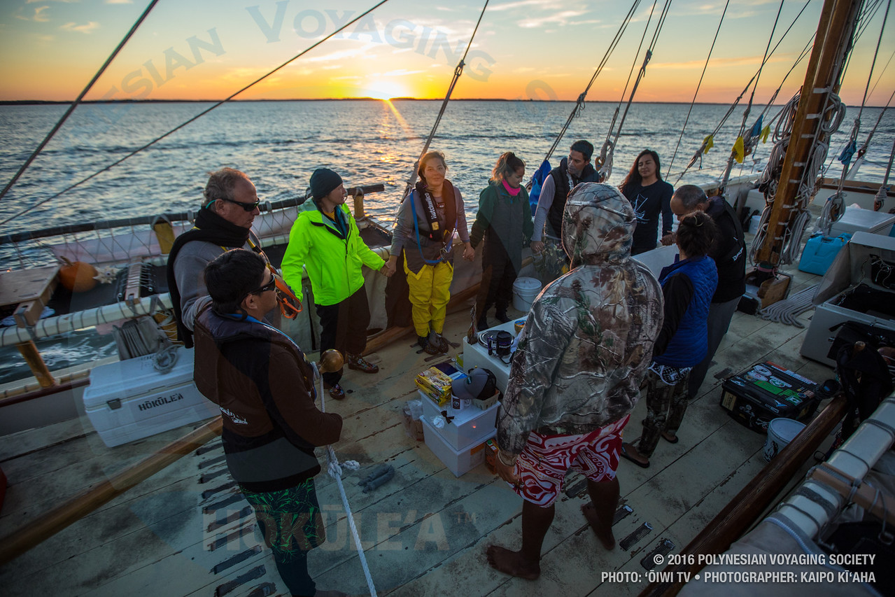 The Leg 24 crew gathers around to pule for dinner.