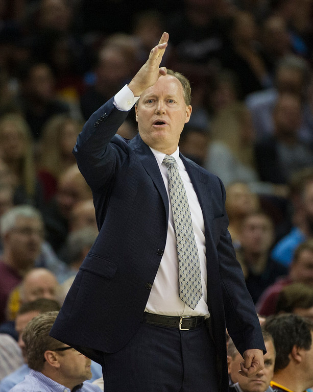 . Atlanta Hawks\' head coach Mike Budenholzer directs his team during the second half of an NBA basketball game in Cleveland, Tuesday, Nov. 8, 2016. The Hawks won 110-106. (AP Photo/Phil Long)