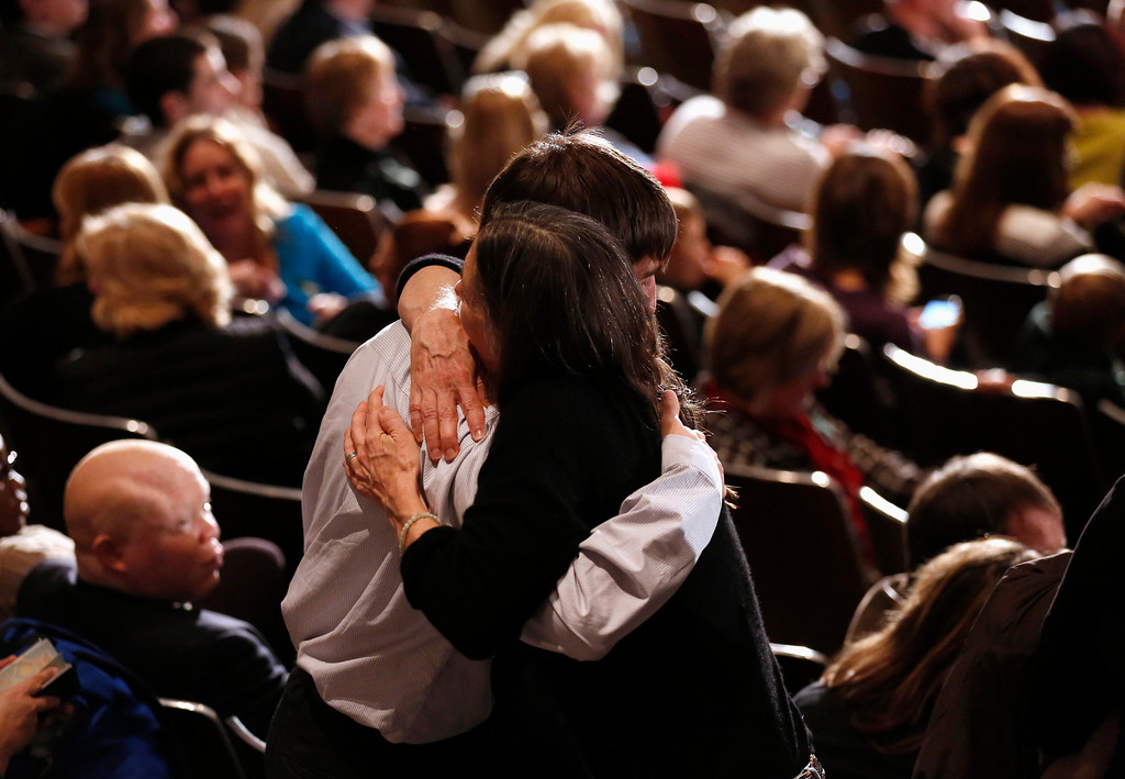 . A young man is comforted during a vigil held at Newtown High School for families of victims of the Sandy Hook Elementary School shooting in Newtown, Connecticut December 16, 2012. U.S. President Barack Obama is visiting Newtown High School to meet with the families of the victims and to thank first responders to the school shooting here, which was one of the deadliest such incidents in the nation\'s history. REUTERS/Kevin Lamarque