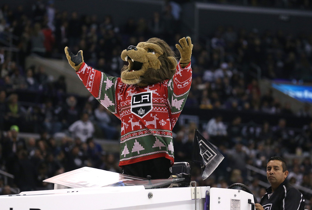 . LOS ANGELES, CA - DECEMBER 21:  Bailey, the mascot of the Los Angeles Kings exhorts the crowd as he rides the ice machine in the game against the Colorado Avalanche at Staples Center on December 21, 2013 in Los Angeles, California.  The Kings won 3-2 on a shootout.  (Photo by Stephen Dunn/Getty Images)