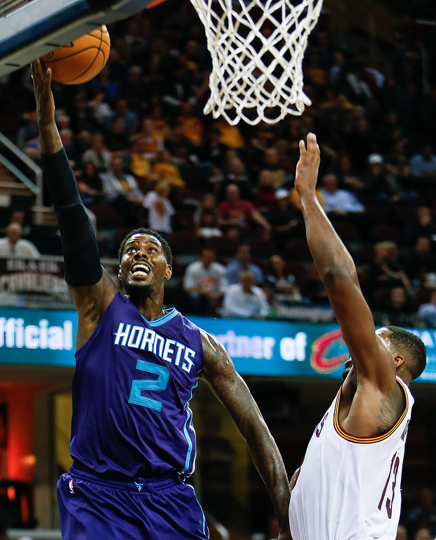 . Charlotte Hornets\' Marvin Williams (2) shoots against Cleveland Cavaliers\' Tristan Thompson (13) during the second half of an NBA basketball game, Sunday, Nov. 13, 2016, in Cleveland. The Cavaliers won 100-93. (AP Photo/Ron Schwane)