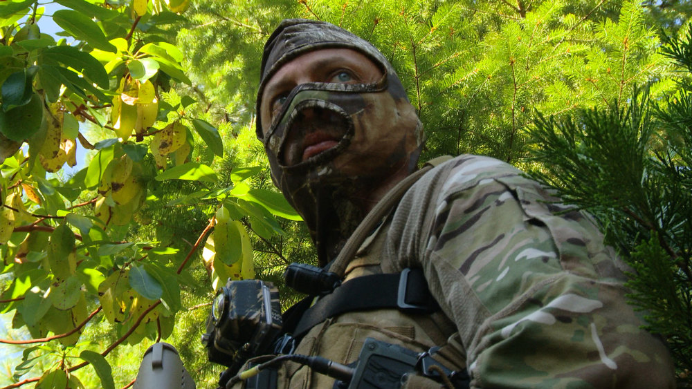 ". Lt. Matt Thomson in combat cammo  in ""Weed Country\"" on Discovery Channel."