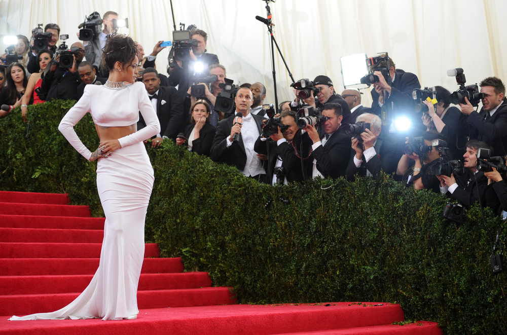 """. Singer Rihanna arrives at The Metropolitan Museum of Art\'s Costume Institute benefit gala celebrating \""""Charles James: Beyond Fashion\"""" on Monday, May 5, 2014, in New York. (Photo by Evan Agostini/Invision/AP)"""