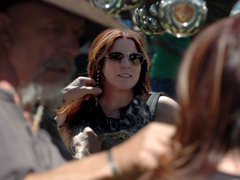 . Paul Reeves, of Sutter Creek, places a hair spiral in Adrienne Medrana, 44 of La Mirada,  hairat the 11th annual Los Angeles County Irish Fair and Celtic Music Festival at the Fairplex in Pomona March 10, 2013. (Thomas R. Cordova/Staff Photographer)