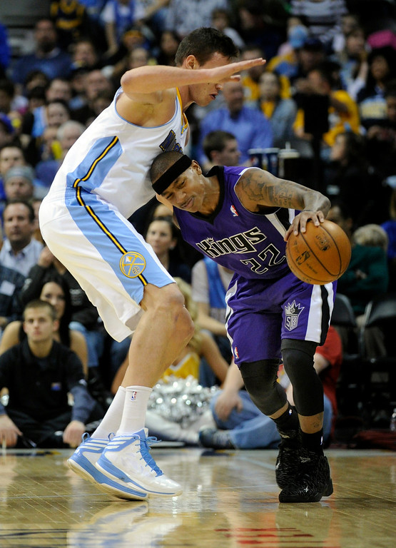 . DENVER, CO. - MARCH 22: Isaiah Thomas (22) of the Sacramento Kings tried to work past Danilo Gallinari (8) of the Denver Nuggets in the first half. The Denver Nuggets hosted the Sacramento Kings Saturday night, March 23, 2013 at the Pepsi Center. (Photo By Karl Gehring/The Denver Post)