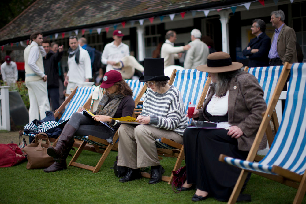 . A woman wearing a Victorian-era style hat notes down information as she prepares to score a normal rules 50 over match after the end of a Victorian-era costume themed cricket match on a wicket in Vincent Square, central London, Wednesday, May 29, 2013.  The two-over-a-side Victorian match was held Wednesday to mark the launch of the 150th anniversary edition of the Wisden Cricketers\' Almanac.  (AP Photo/Matt Dunham)