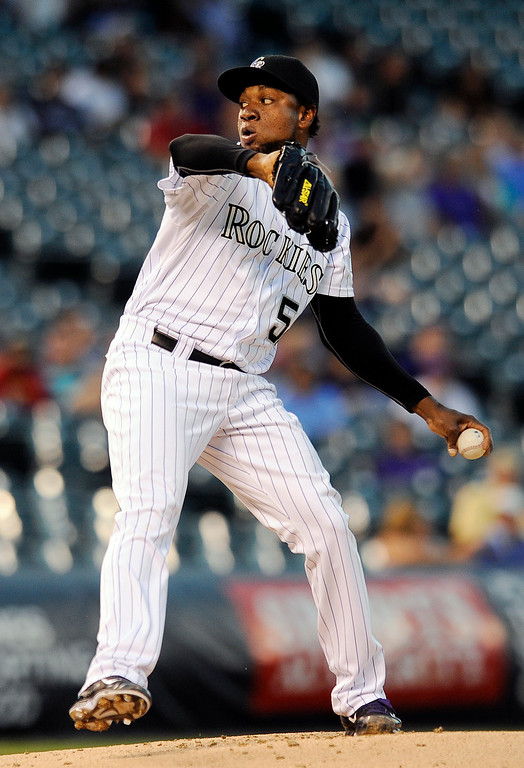 . Colorado Rockies starting pitcher Yohan Flande throws in the second inning of a baseball game against the Arizona Diamondbacks, Thursday, Sept. 18, 2014, in Denver. (AP Photo/Chris Schneider)