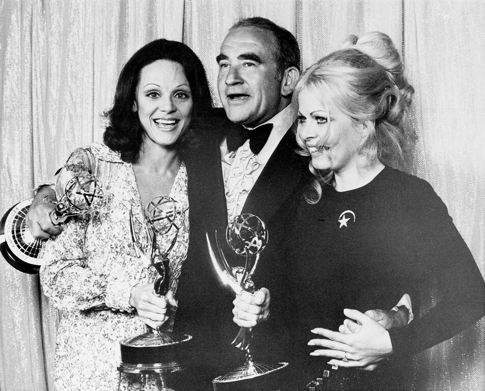 """. Valerie Harper, left, Ed Asner, center, and Sally Struthers hold their Emmys at the 24th annual Primetime Emmy Awards presentation in Hollywood, Ca., Sunday night, May 14, 1972.  Harper and Asner won best supporting actress and actor, respectively, in \""""The Mary Tyler Moore Show.\""""  Struthers won for her role in \""""All in the Family.\""""  (AP Photo)"""