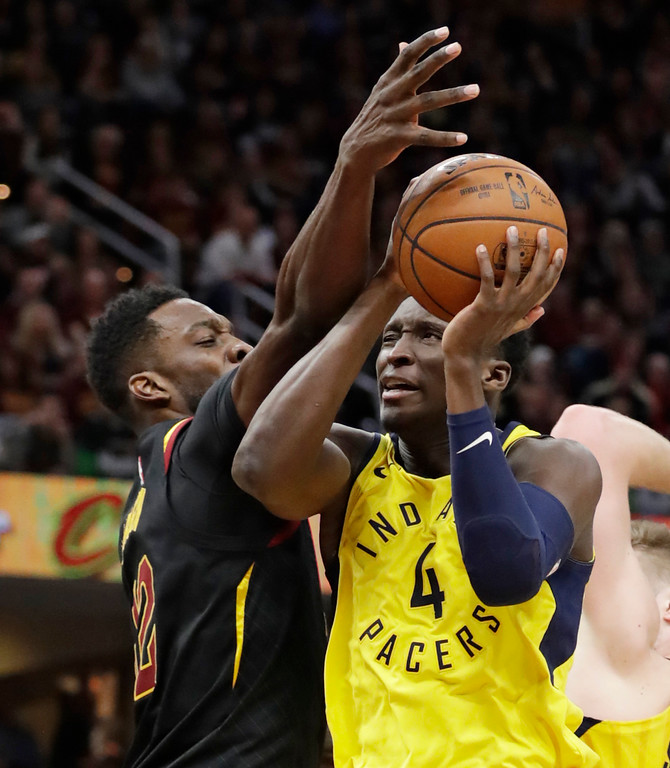 . Indiana Pacers\' Victor Oladipo, right, drives against Cleveland Cavaliers\' Jeff Green in the second half of Game 5 of an NBA basketball first-round playoff series, Wednesday, April 25, 2018, in Cleveland. The Cavaliers won 98-95.(AP Photo/Tony Dejak)
